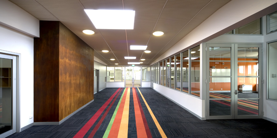 The carpet uses directional coloured inlays throughout to break up the large spaces