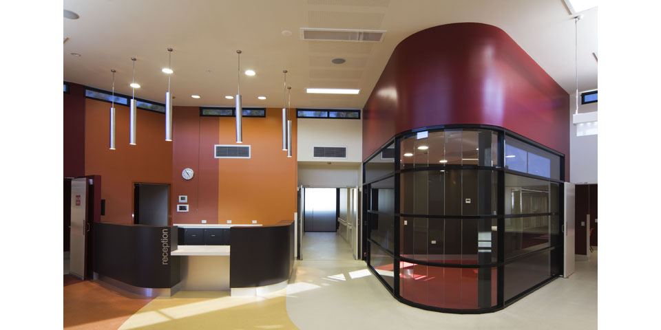 The interior uses a warm palette of materials instead of the cooler colours associated with healthcare