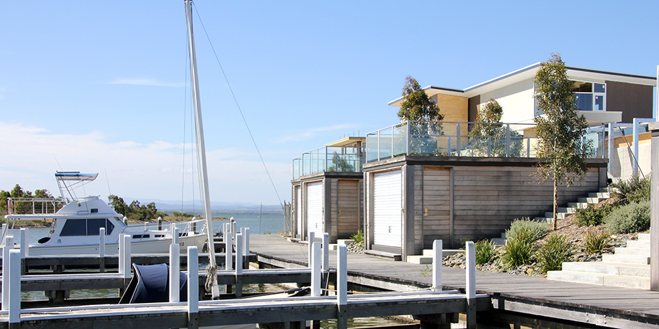the boathouses have uninterupted views across to the ocean and mountains beyond.