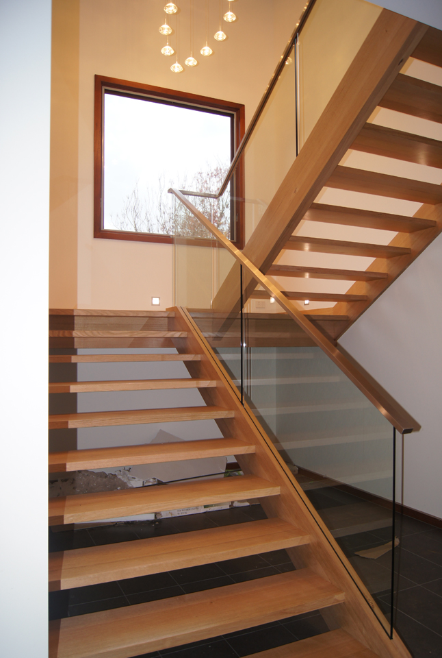 The stair lets natural light into the double height space